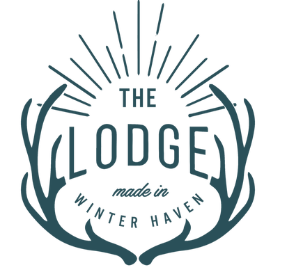 The Lodge logo in teal